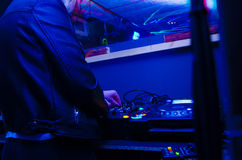 DJ booth. A disc jockey standing in dj booth producing music live Royalty Free Stock Photos