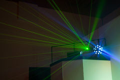 DJ Booth Lights. Disc Jockey Laser lights and disco ball booth at a night club Royalty Free Stock Image
