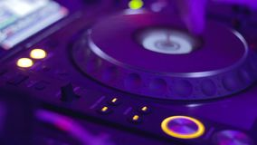 DJ CD turntable blinks until female hand turns it off. Stock footage stock video footage