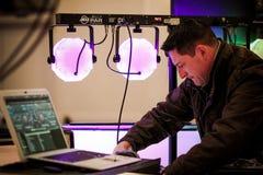 DJ checks his equipment Royalty Free Stock Photo