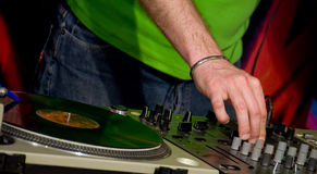 DJ in the club. A detail of a gramophone disc with a DJ�s hand Royalty Free Stock Image