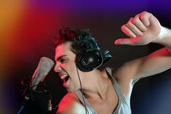 Dj with colorful light and music mixing equipment Stock Photos