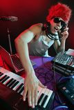 Dj with colorful light and music mixing equipment Royalty Free Stock Photography