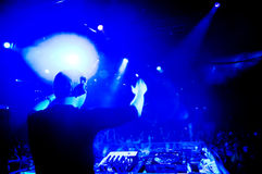 Dj at the concert. Blurred motion Royalty Free Stock Photo