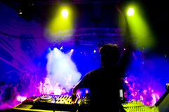 Dj at the concert, blurred motion. Laser show and music Royalty Free Stock Images
