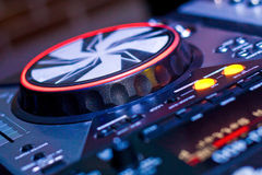 DJ console. With knobs in night club Stock Images
