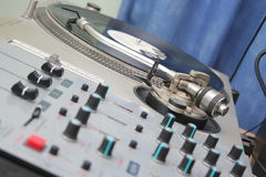 DJ Console. A DJ console with knobs and a disc scratcher Stock Images