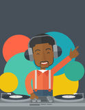 DJ with console Royalty Free Stock Image