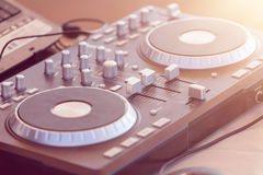 DJ console, CD player and mixer in nightclub Royalty Free Stock Image