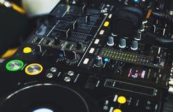 DJ console with DJ headphones close up royalty free stock photos