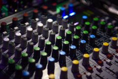 DJ console. Green yellow Backlight party night Stock Photos