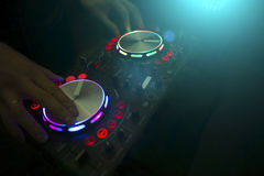 DJ console mixer controlling with two hand Stock Photography