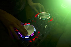 DJ console mixer controlling with two hand Royalty Free Stock Image