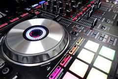DJ console. Mixing desk colored lights Stock Image