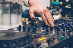DJ console on the performance party. Creating music and tuning DJ royalty free stock photography
