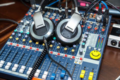 DJ control, volume control. Equipment for parties to DJ headphones, the sound wave, volume control, music remixes, wires Royalty Free Stock Photography