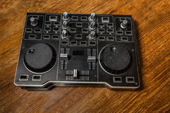 Dj Controller old, on with table wood. Woodden background Royalty Free Stock Images