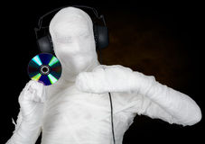 DJ costume mummy with ear-phones and disc Royalty Free Stock Photo