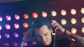DJ dancing at a electronic night club party. stock footage
