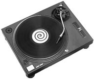 DJ Deck. A black turntable with a record playing on it Royalty Free Stock Photos