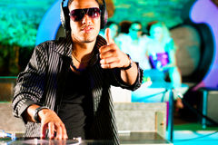 DJ in disco club, crowd background Royalty Free Stock Photo