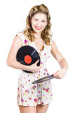 DJ disco pin-up girl rocking out to retro vinyl Stock Photos