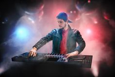 DJ ;Disk Jockey; is mixing music in nightclub stock photography