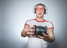 DJ divertido con Cdes Imagen de archivo libre de regalías