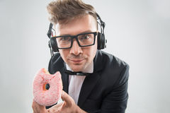 Dj eating donut on working place close-up Stock Photos