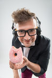 Dj eating donut on working place close-up Royalty Free Stock Image