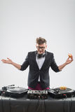 Dj eating donut on working place turntable Royalty Free Stock Image