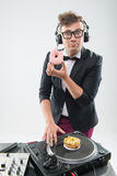 Dj eating donut on working place turntable Stock Photo