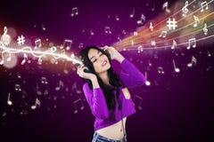 Dj enjoy music with purple background Stock Image
