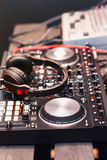 DJ equipment, headphones, microphones, vinyl. DJ equipment and headphones, before the party stock photos