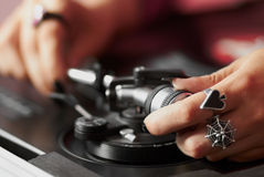 DJ fitting needle to turntable tonearm Royalty Free Stock Photos