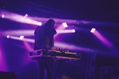 DJ on the Stage. DJ on the Floodlit Stage Filled with Smoke royalty free stock images