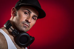 DJ in front of a red Background Stock Image