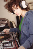 DJ Girl. Young female DJ practicing her spinning & mixing Stock Images