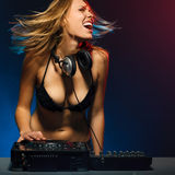 DJ girl on decks Royalty Free Stock Images