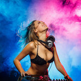 DJ girl on decks Royalty Free Stock Image