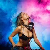 DJ girl on decks Royalty Free Stock Image