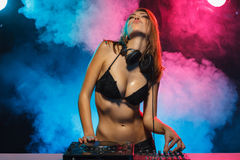DJ girl on decks Royalty Free Stock Photos
