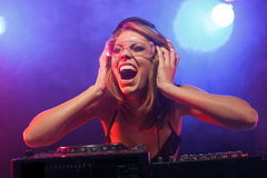 DJ girl on decks Royalty Free Stock Photos