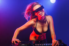 DJ girl on decks Stock Image