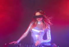 DJ girl on decks at the party. Beautiful DJ girl on decks at the party Stock Photos