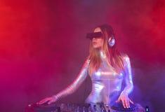 DJ girl on decks at the party. Beautiful DJ girl on decks at the party Royalty Free Stock Photo