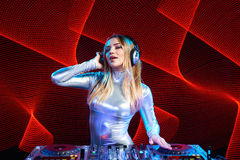 DJ girl on decks at the party Stock Photography