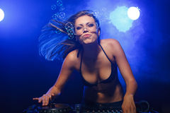 DJ girl on decks Stock Photo