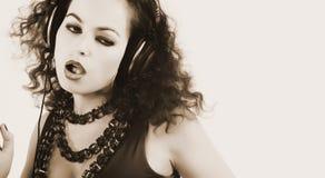 DJ girl in headphones Stock Photo