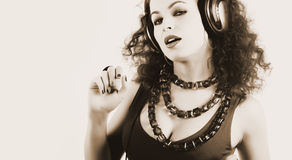 DJ girl in headphones Stock Images